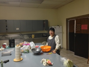 A volunteer in the kitchen.