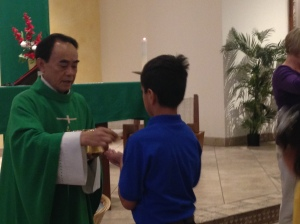 A student receiving Holy Communion.