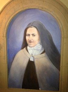 A portrait of St. Therese of the Child Jesus.