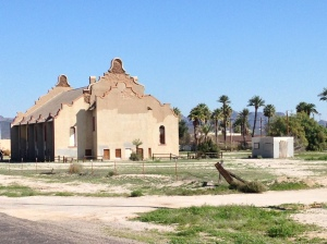 An abandoned Baptist Church made of adobe.