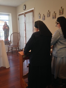 Sister Margery Therese and Sister Mary Eileen at prayers.