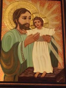 St. Joseph holding Jesus.