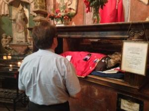 A Pilgrim Venerating a Statue of San Xavier
