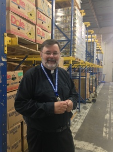 Fr. Bud explains how much food comes in to be organized and prepared.