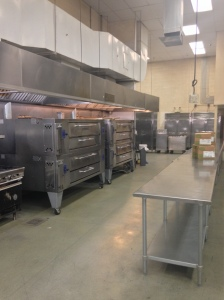 The kitchen is incredible with ovens to make pizza. These ovens were donated by a benefactor!
