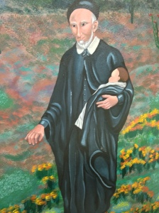 St. Vincent de Paul, Patron of charitable activities.