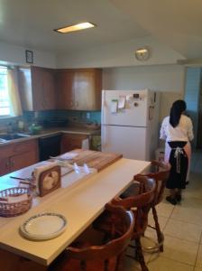 Sr. Marie preparing supper in the kitchen.