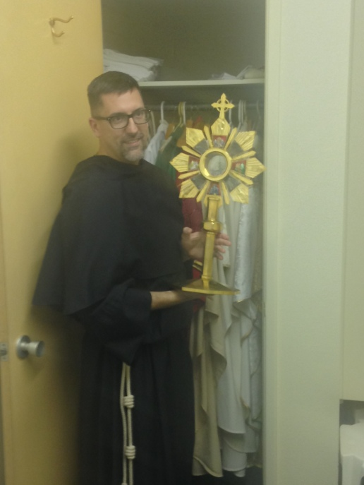 Fr. Augustine with a Monstrance