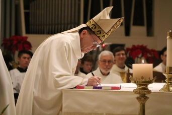 Bishop Olmsted witnessing her vows